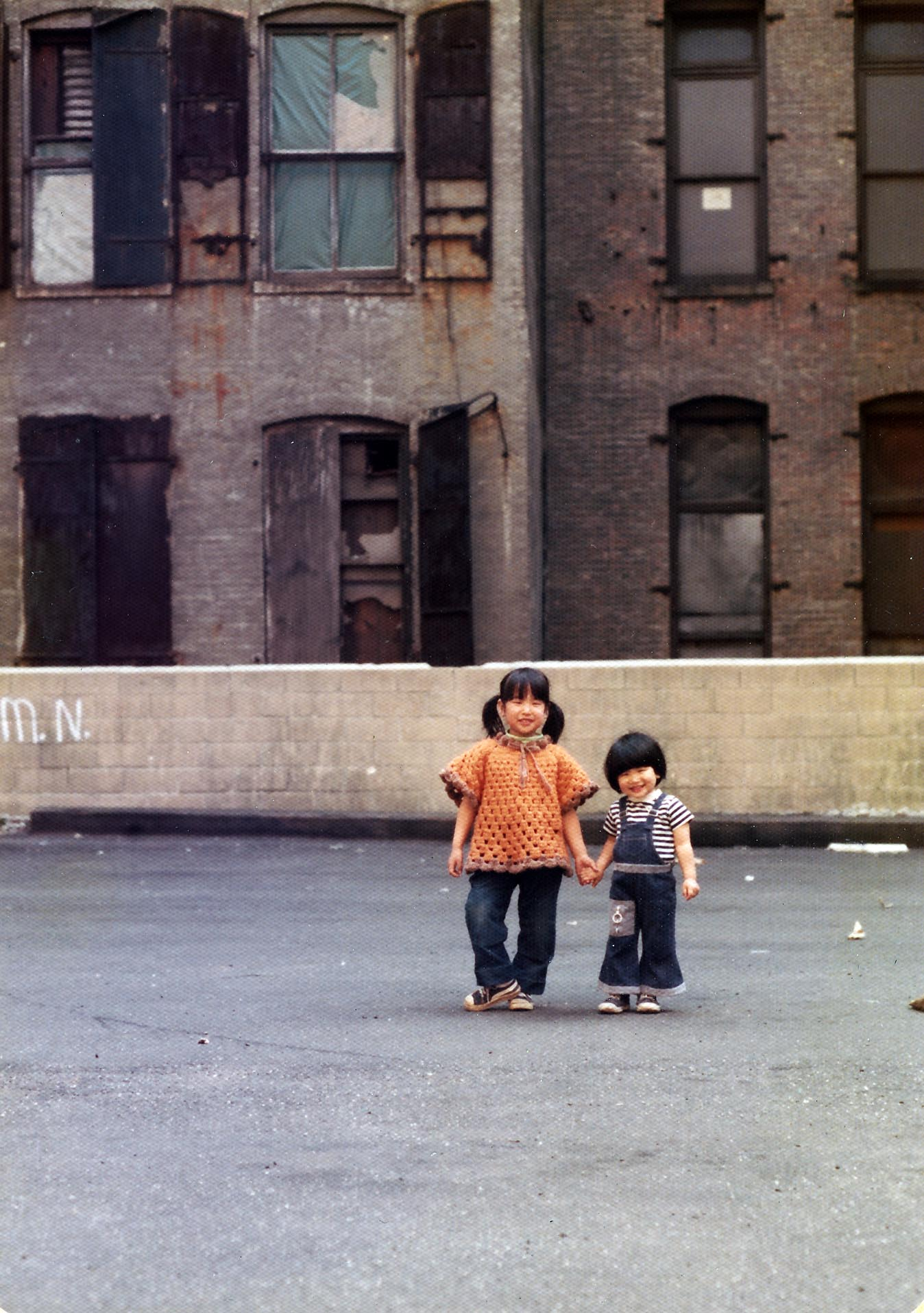 This photo of me and my sister was taken in 1974 in the parking lot on Crosby Street between Prince and Spring, the current site of the Crosby Hotel, where we would often play.