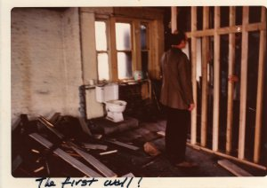 Mike, Jane's husband, inspecting the installation of the first wall in the loft. (image: Cass Collins)