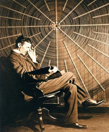 "Nikola Tesla in front of the spiral coil of his high-frequency transformer at East Houston St., New York City..—Photographed by Tonnele & Co."" From ""Tesla's Important Advances,"" Electrical Review, 20 May 1896, 263."