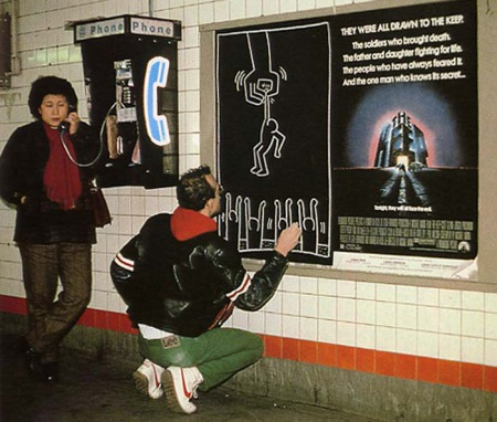 Keith Haring drawing in a subway station.