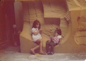 Children lounging on a sculpture ca. 1975