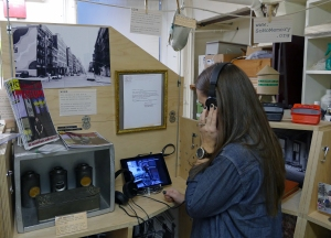A visitor watches a film at the SMP Portable Historical Society