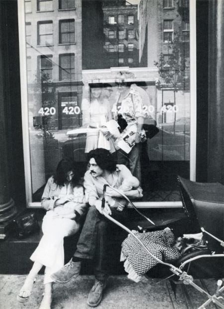 Young family in front of 420 West Broadway. There were lots of people starting families here. (Horizon Magazine)