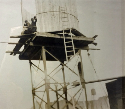 Isseks Brothers water tank being constructed on a New York City Rooftop back in the early days
