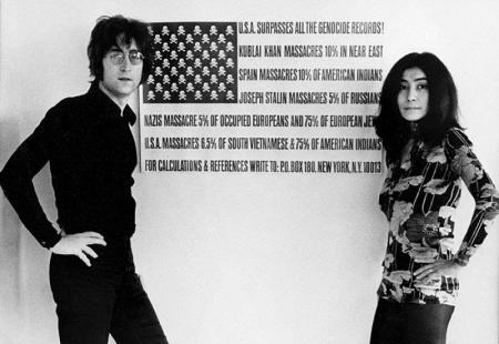 More details John Lennon and Yoko Ono standing in front of Maciunas' USA Surpasses all the Genocide Records!, c.1970 (photo: Wikipedia)